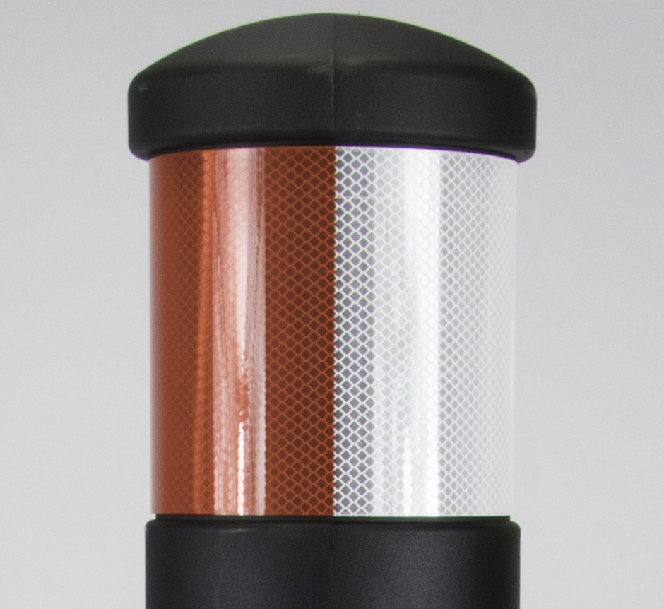 Red and white reflective bollard for traffic calming